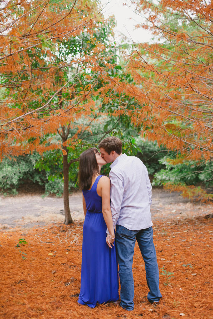 Fall outdoor engagement photos under tree with orange leaves - Photo by Laura Elizabeth Photographers