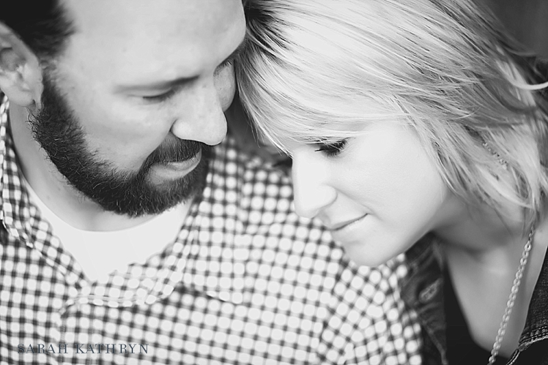Close up black and white engagement portrait with couples heads touching - Photo by Sarah Kathryn Portrait Design