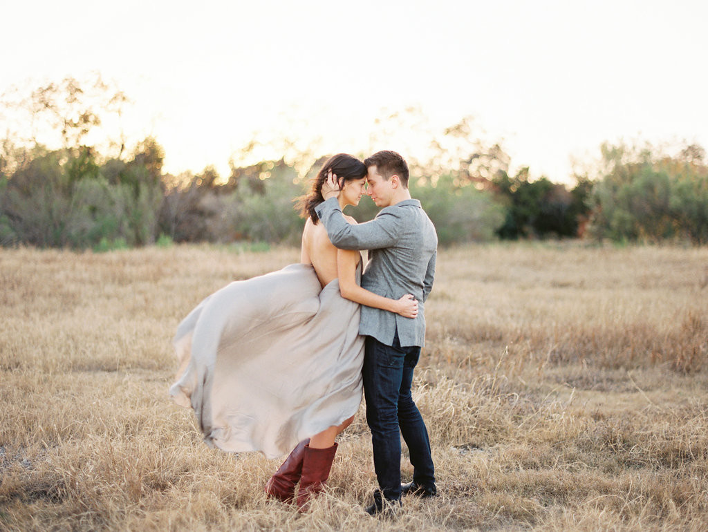 Gorgeous outdoor engagement photos couple standing in a field in the fall - Photo by Joshua Aull Photography