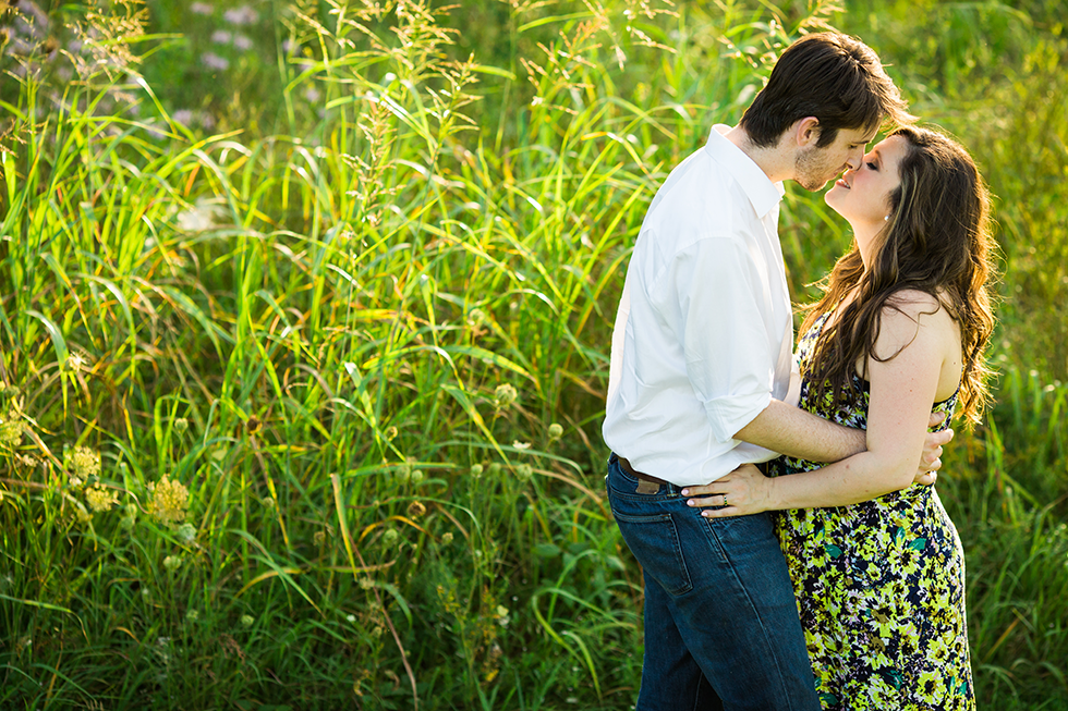 Engagement photos in field - Photo by Lightbox Photography