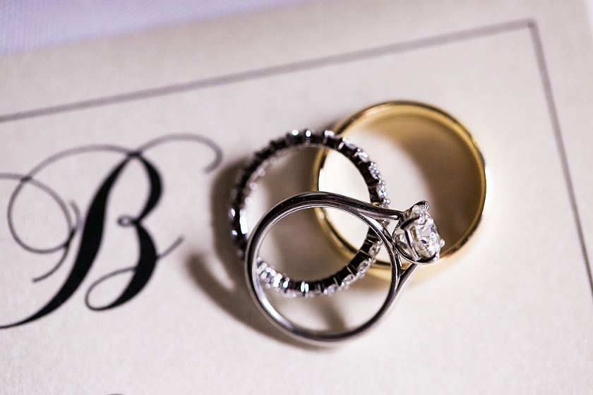 Wedding rings on invitation - Photo by Jenny Martell Photography