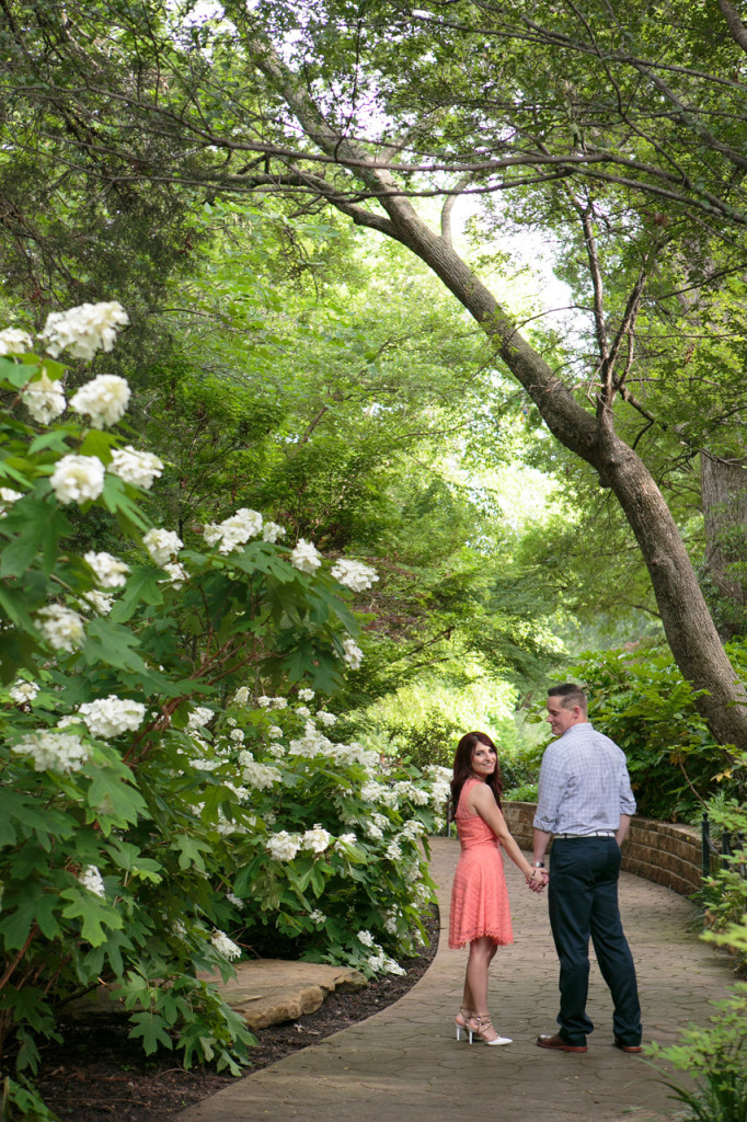 Outdoor engagement photo with bridge - Photo by The Mamones
