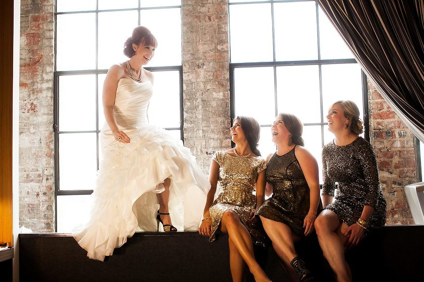 Bride with bridesmaids laughing - Photo by Jenny Martell Photography