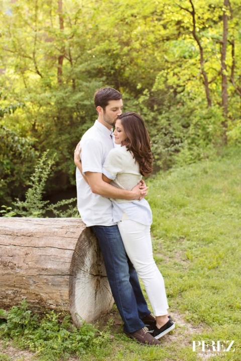 Outdoor engagement photo on log - Photo by Perez Photography