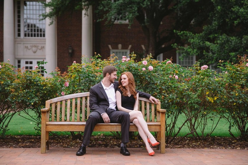 Outdoor engagement pictures at Southern Methodist University in Dallas, TX couple sitting on bench outside - Photo by Evan Godwin Photography