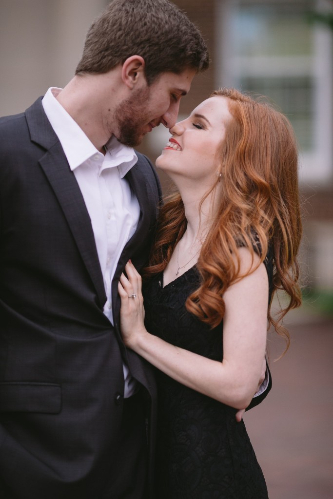 Outdoor engagment pictures with cute couple touching noses and smiling - Photo by Evan Godwin Photography