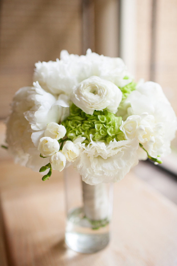 White and green bridal bouquet with a stem wrapped in white ribbon for summer wedding - Photo by Victor Rosas Photography