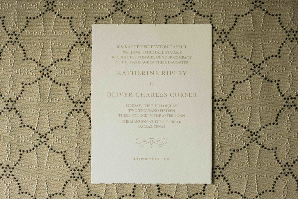 Traditional ivory wedding invitation with decorative script - Photo by Lightbox Photography