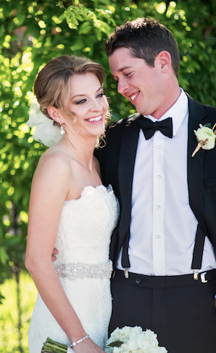 bride-and-groom-at-summer-wedding-at-the-ashton-depot-in-fort-worth-tx-bride-in-lace-strapless-dress-with-beaded-belt-and-all-white-wedding-bouquet-photos-by-devon-j-imagery