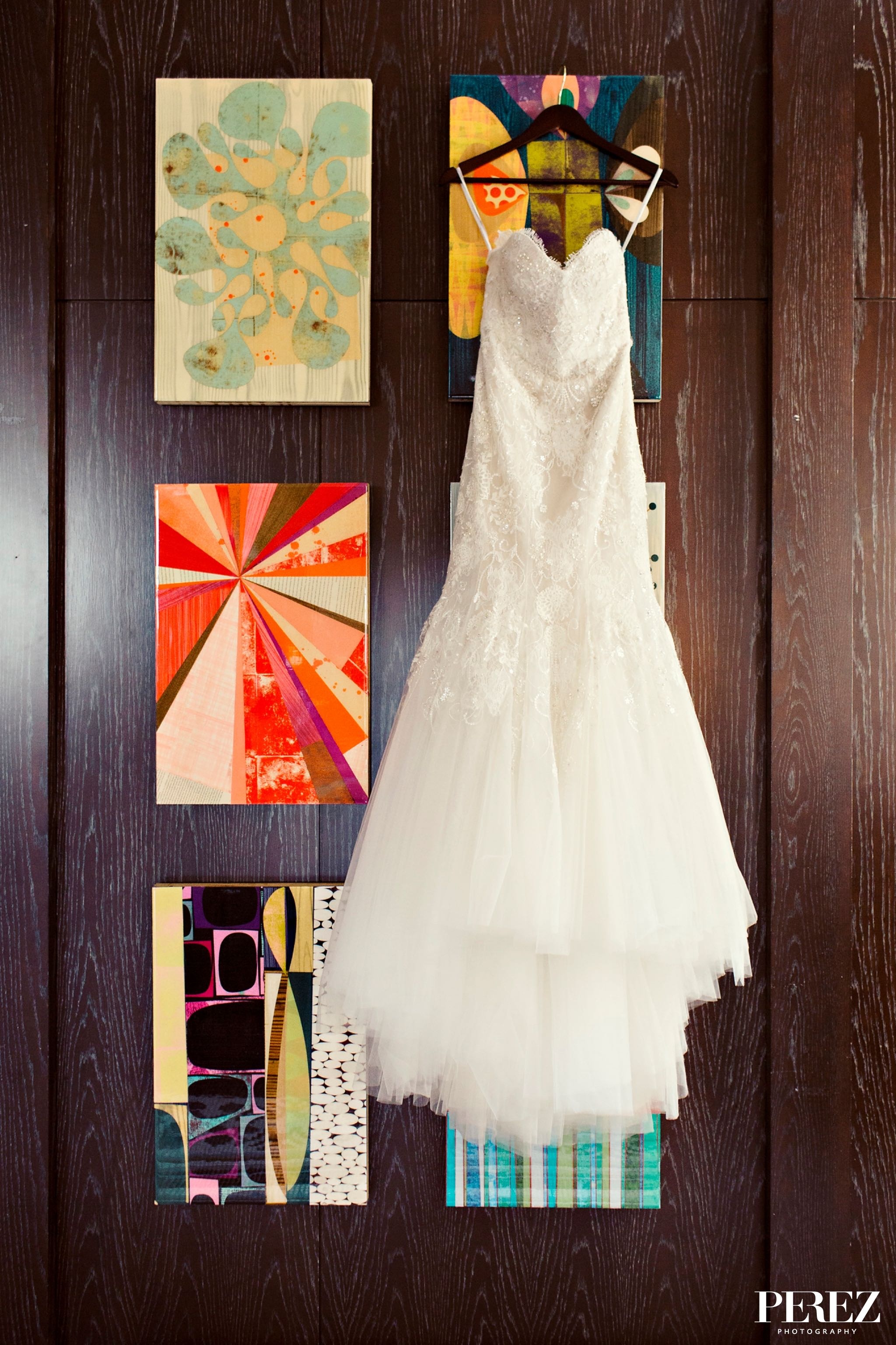 Brides strapless lace wedding dress hanging in Penthouse suite of The Joule Hotel before winter wedding - Photos by Perez Photography