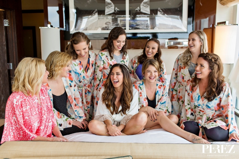 Bride and bridesmaids getting ready for formal winter wedding at The Joule Hotel in Dallas, Texas - Photos by Perez Photography