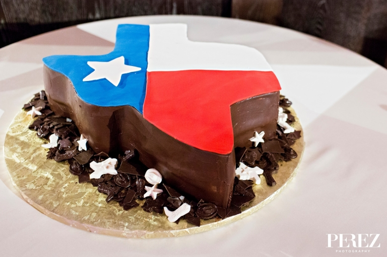 Grooms custom Texas shaped chocolate cake for winter wedding reception at The Joule Hotel in Dallas, Texas - Photos by Perez Photography