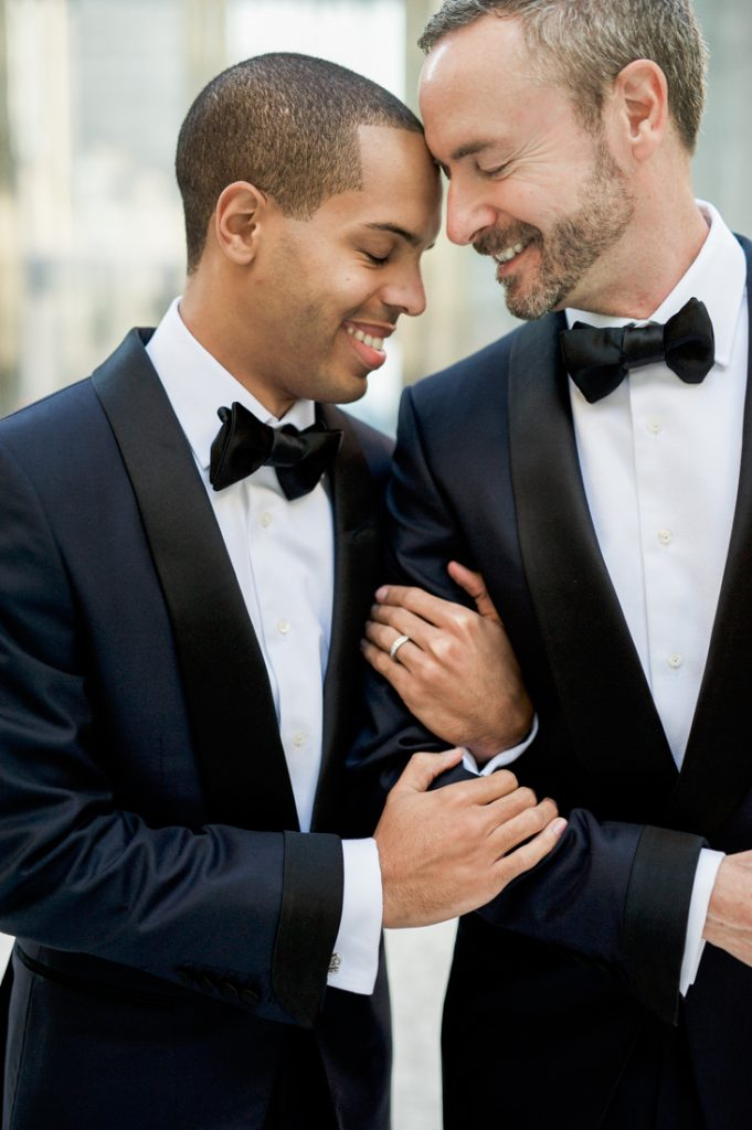Outdoor winter engagement photos at The Joule Hotel in Dallas, Texas with two grooms for Winter Wonderland formal wedding - Photos by Shannon Skloss Photography