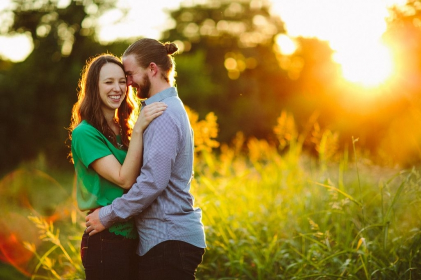 Outdoor engagement photos in field at sundown in Dallas, Texas - Photos by Honey and Salt Photography