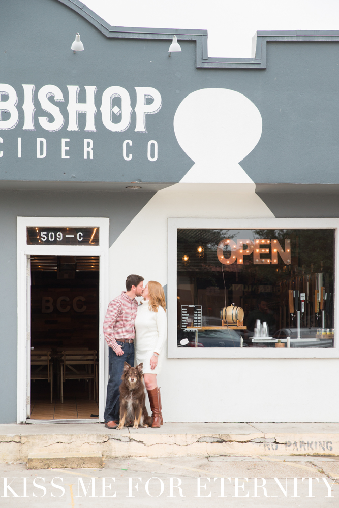Engagement photo shoot outside Bishop Cider Company in Bishop Arts Dallas, Texas with dog on a leash - Bishop Cider Company engagement photo shoot in Dallas, Texas - Photos by Kiss Me For Eternity