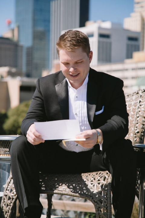 Groom reading note from bride at loft in Downtown Dallas, Texas before winter wedding - Photo by Evan Godwin Photography