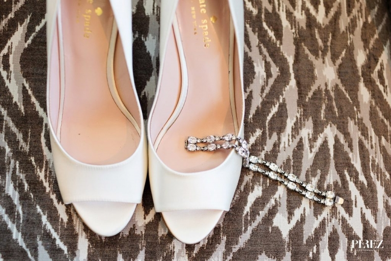 Brides white Kate Spade shoes and diamond bracelet before spring wedding in Dallas, Texas - Photos by Perez Photography