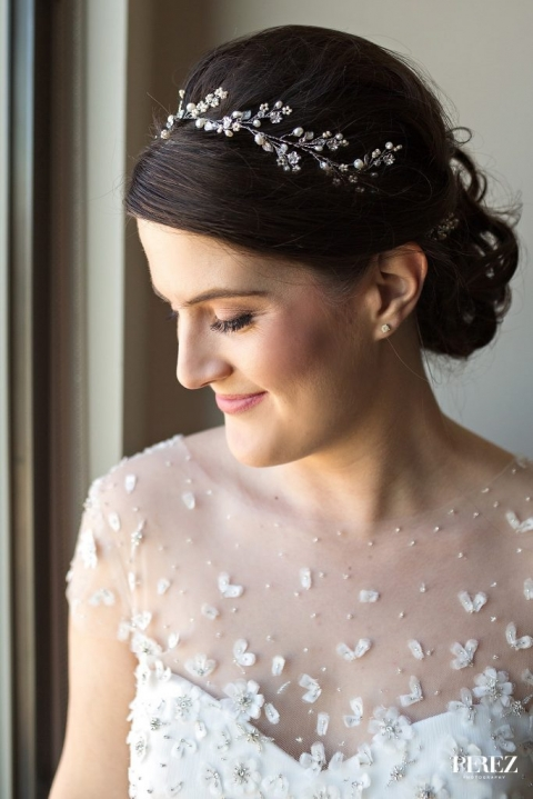 Bride with jeweled head piece taking photos before spring wedding ceremony in Dallas, Texas - Photos by Perez Photography