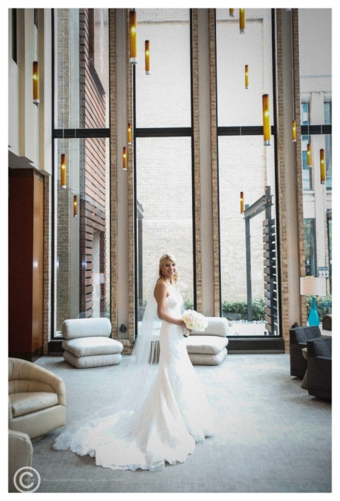 Spring bride posing in lobby of The Highland Hotel in Dallas, Texas - Photo by Relive Photography by Laura Parent