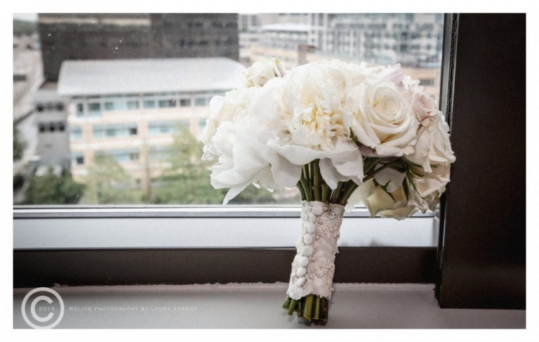 Brides spring all white wedding bouquet with lace and button details - Photo by Relive Photography by Laura Parent