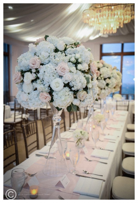 Large round floral centerpieces on glass vases for spring wedding reception at Cityplace in Dallas, Texas - Photo by Relive Photography by Laura Parent