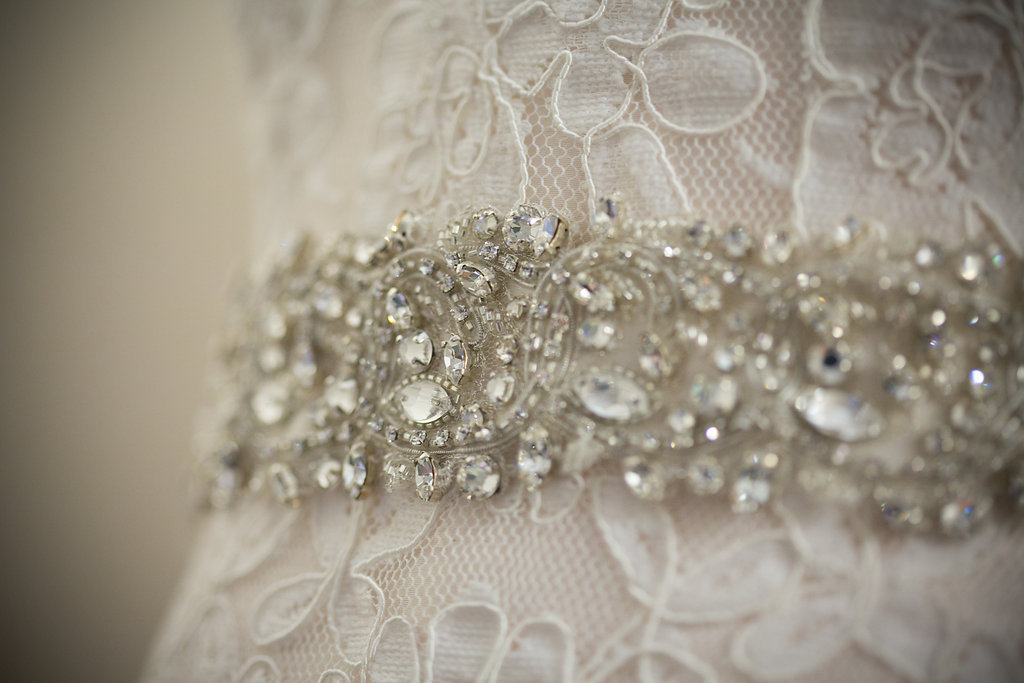 Lace wedding dress with jeweled belt for summer wedding in Dallas, TX - Photos by The Mamones