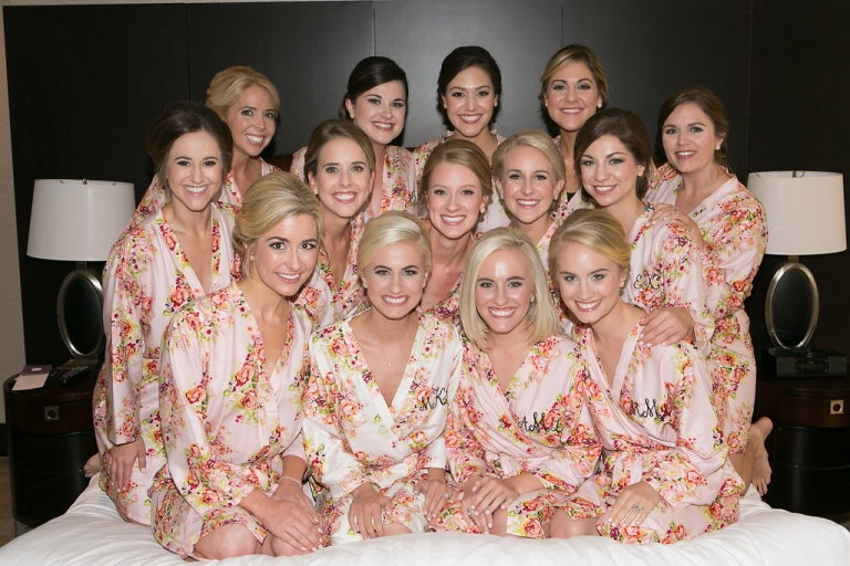 Bride and bridesmaids in matching floral robes bridesmaid gift idea for summer wedding in Dallas, TX - Photos by The Mamones
