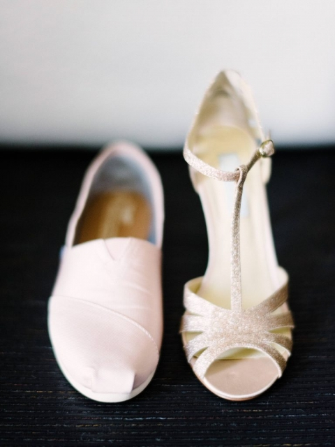 Brides two pairs of wedding shoes heels for ceremony Toms for wedding reception for Dallas summer wedding - Photos by The Waldron Photography Company
