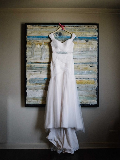 Brides wedding dress hanging up on custom last name hanger before summer wedding ceremony in Dallas, Texas - Photos by The Waldron Photography Company