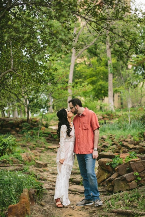Outdoor engagement picture inspiration wooded area - Photos by Andrew Chan Weddings