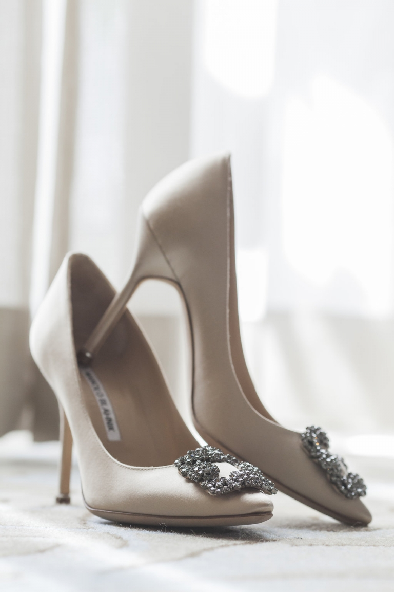 Bride's nude Manolo Blahnik wedding shoes for fall wedding at Hotel Crescent Court in Dallas, Texas - Photos by Havi Frost Photography