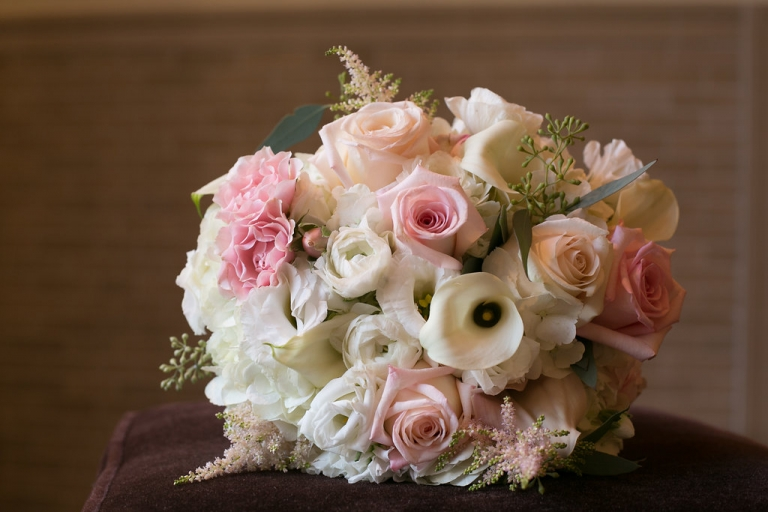 Brides wedding bouquet with white cream and pink flowers for fall wedding in Dallas, Texas - Photos by The Mamones