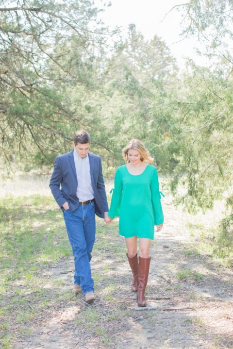 Outdoor engagement photos in wooded area - Photos by Kiss Me For Eternity