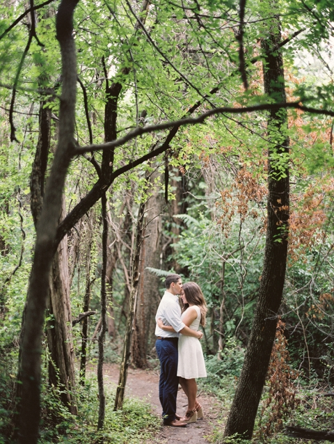Outdoor engagement photos in forest with bride wearing white dress - Photos by Sarah Kate