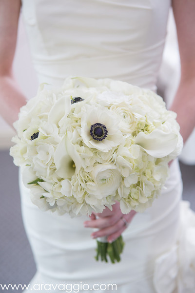 All white brides spring wedding bouquet - Photo by Aravaggio Photography