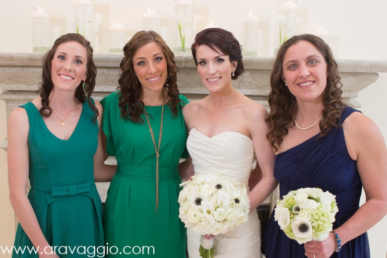 Bride with bridesmaids in mismatched bridesmaid dresses in various colors - Photo by Aravaggio Photography