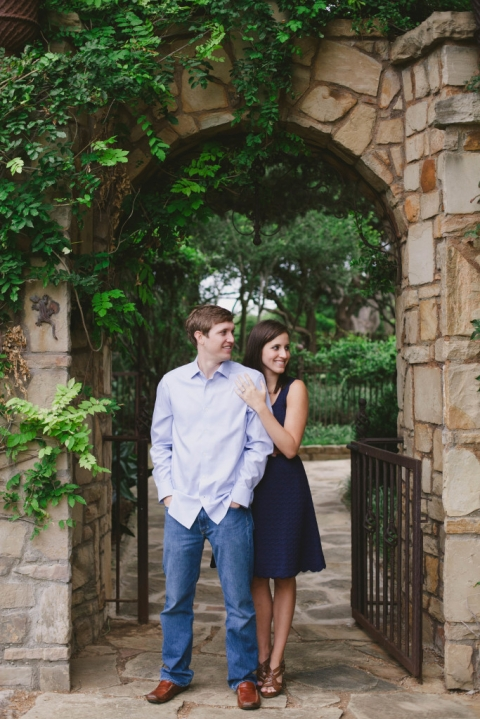Outdoor engagement photos under stone archway - Photo by Laura Elizabeth Photographers