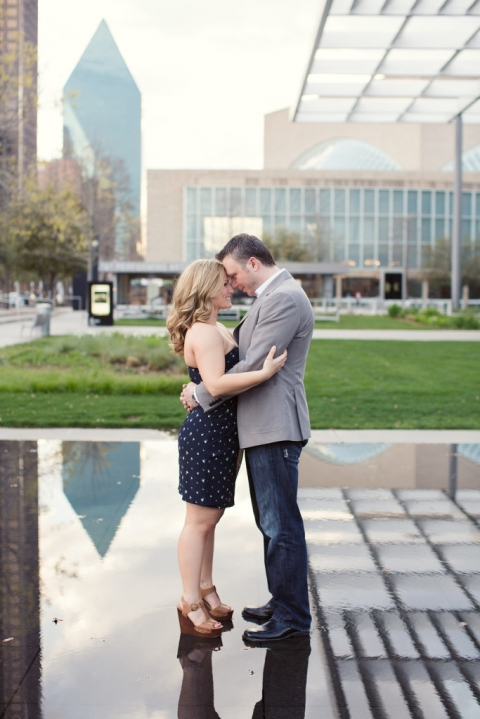 Cute couple posing outside Winspear Opera House in Dallas, TX outdoor engagement photos -  Photo by Joshua Aull Photography
