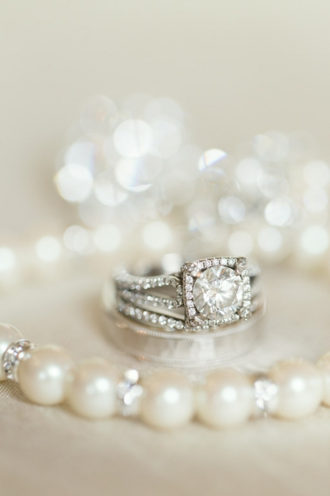 Close up detail shot of wedding rings with pear bracelet - Photo by Ben Q. Photography