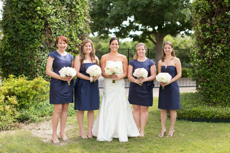 Bride and bridesmaids outside at Filter Building bridesmaids in short navy mismatched dresses - Photo by Ben Q. Photography