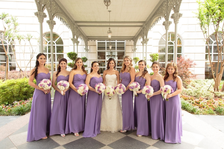 Bride and bridesmaids in lavender strapless floor length dresses - Photo by Joseph Mark Photography