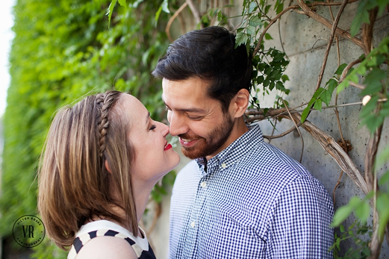Engagement photo on wall with vines - Photo by Victor Rosas Photography