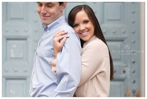Outdoor engagement photo in front of blue door - Photo by Hilary Rattikin Photography