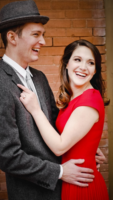 Engagement photo with brick wall- Photo by Jenny & Eddie