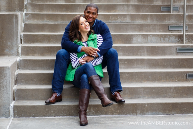 Engagement photo on stairs - Photo by The Amber Studio