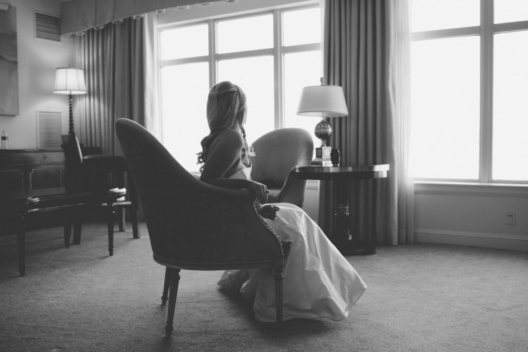 Bride in wedding dress in chair - Photo by Stephanie Brazzle Photography