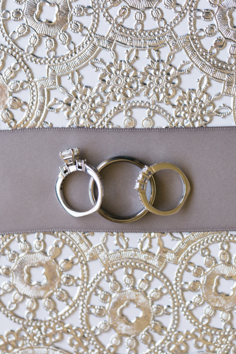 Wedding rings on invitation - Photo by Stephanie Brazzle Photography