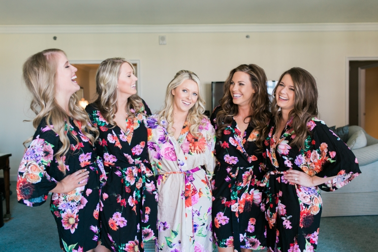 Bride and bridesmaids in matching floral robes - Photo by Stephanie Brazzle Photoraphy