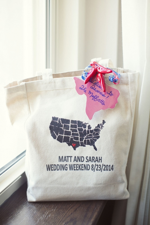 Dallas, TX wedding out of town custom guest gift bag with heart on the state of Texas and bride and grooms name and wedding date in canvas tote bag with state of Texas gift tag and jalapenos - Photos by Sarah Kate