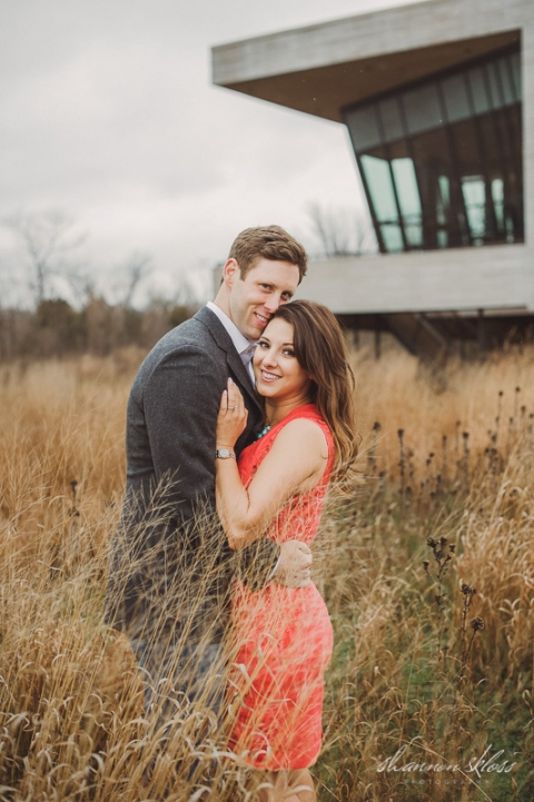 Engagement photo in field - Photo by Shannon Skloss Photography